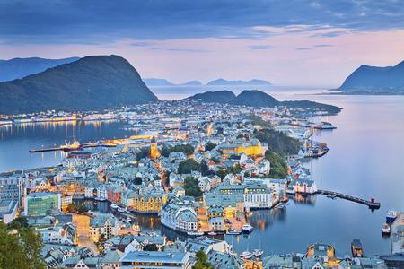 scandinavian peninsula: Alesund, Norway  Image of norwegian city of Alesund during twilight blue hour  Stock Photo