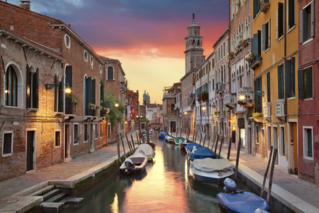 italy culture: Venice. Image of one of many narrow canals in Venice during beautiful sunset. Stock Photo