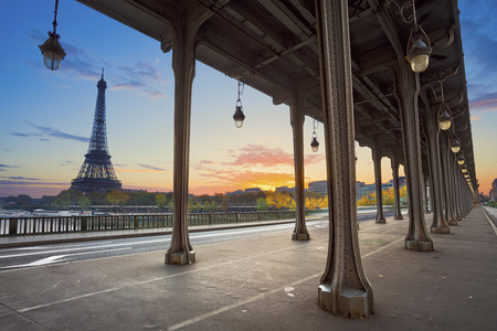Paris. Eiffel Tower and Bir Hakeim Bridge in Paris, France during sunrise.