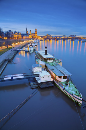 western europe: Dresden. Image of Dresden, Germany during twilight blue hour with Elbe River in the foreground.