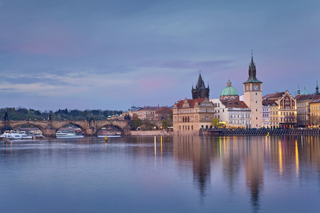 charles bridge: Prague. Image of Prague riverside and Charles Bridge, with reflection of the city in Vltava River. Editorial