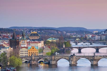 czech culture: Prague. Image of Prague, capital city of Czech Republic with Charles Bridge and many other bridges crossing Vltava River.