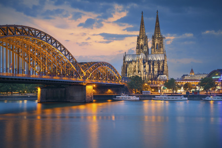 Cologne Germany. Image of Cologne with Cologne Cathedral and Hohenzollern bridge across the Rhine River. Stock Photo