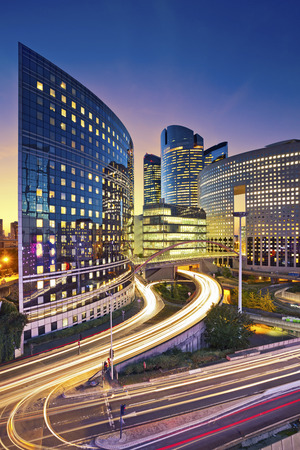 La Defense Paris. Image of office buildings in modern part of Paris La Defense during sunset.