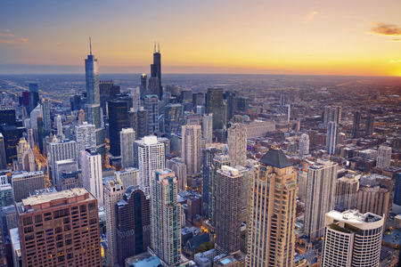 suburb: Chicago. Aerial view of Chicago downtown at twilight from high above. Stock Photo