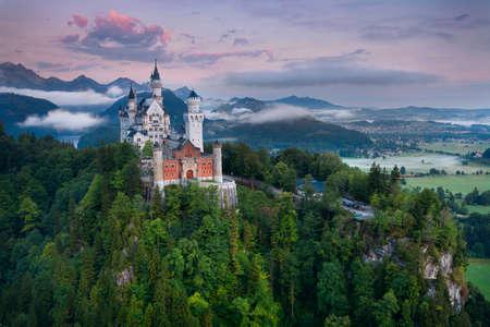 castle: Neuschwanstein Castle. View of Neuschwanstein Castle, Germany during foggy summer morning.
