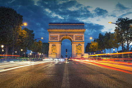 french culture: Arc de Triomphe. Image of the iconic Arc de Triomphe in Paris city during twilight blue hour.