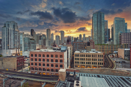 dramatic sunrise: Chicago downtown. Image of modern downtown district of Chicago at sunrise.