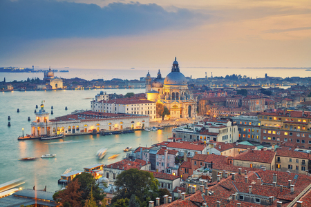 sea port: Venice. Aerial view of the Venice with Basilica di Santa Maria della Salute taken from St. Marks Campanile. Stock Photo