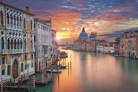 and streetlights: Venice. Image of Grand Canal in Venice, with Santa Maria della Salute Basilica in the background.