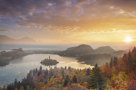 bled: Autumn Lake Bled. Lake Bled with St. Marys Church of the Assumption on the small island. Bled, Slovenia, Europe.