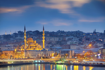cami: Istanbul. Image of Istanbul with Yeni Cami Mosque during sunrise. Stock Photo