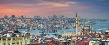 Istanbul Panorama. Panoramic image of Istanbul with Yeni Cami Mosque and Galata Bridge during sunset. Stock Photo