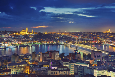 blue mosque: Istanbul. Image of Istanbul with Suleymaniye Mosque and Golden Horn Metro Bridge during twilight blue hour.