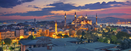 Istanbul Panorama. Panoramic image of Hagia Sophia in Istanbul, Turkey during sunrise. Stock Photo