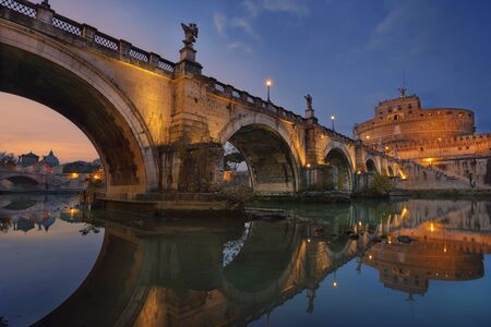 holy night: Rome. Image of the Castle of Holy Angel and Holy Angel Bridge over the Tiber River in Rome at sunset.