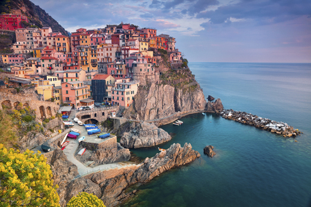 local landmark: Manarola. Image of Manarola, Cinque Terre, Italy, during sunset. Stock Photo