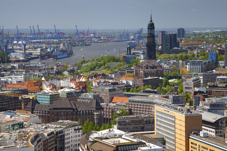 overhead crane: Hamburg. Aerial image of Hamburg with the St. Michael church and harbour. Stock Photo