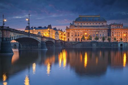 vltava river: Prague. Image of Prague riverside with reflection of the city in Vltava River and National Theatre.