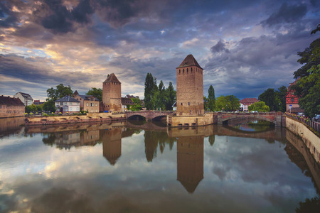 french culture: Strasbourg. Image of Strasbourg old town during dramatic sunset. Stock Photo