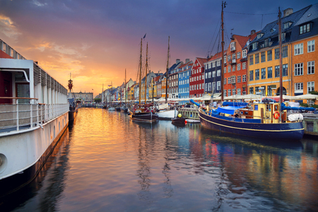 Copenhagen, Nyhavn Canal. Image of Nyhavn Canal in Copenhagen, Denmark during beautiful sunset. Standard-Bild