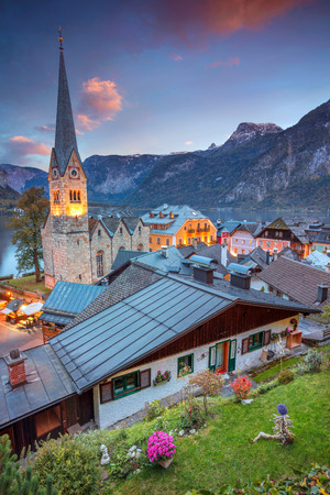 roof ridge: Hallstatt, Austria. Image of famous alpine village Hallstatt during autumn sunset.