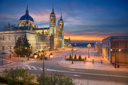 Madrid. Image of Madrid, Spain with Santa Maria la Real de La Almudena Cathedral during sunset.