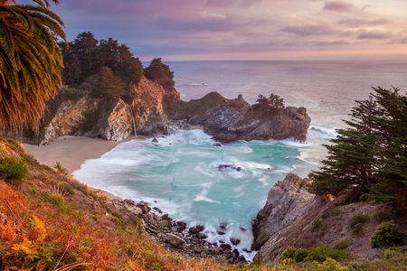 Pacific Coast. Beautiful beach at Julia Pfeiffer Burns State Park located in Big Sure area at Pacific coast, California during sunset. Stock Photo