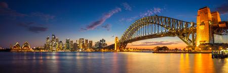 harbour: Sydney. Panoramic image of Sydney, Australia with Harbour Bridge during twilight blue hour.