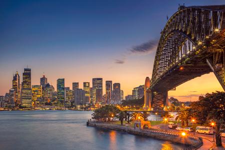 harbour: Sydney. Cityscape image of Sydney, Australia with Harbour Bridge during summer sunset.