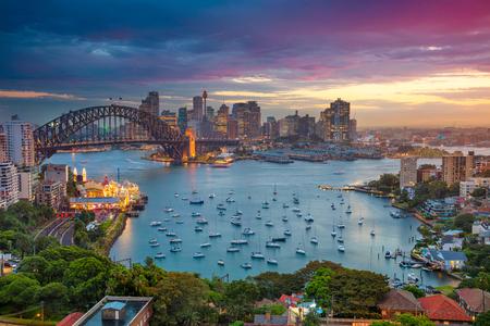 harbours: Sydney. Cityscape image of Sydney, Australia with Harbour Bridge and Sydney skyline during sunset.