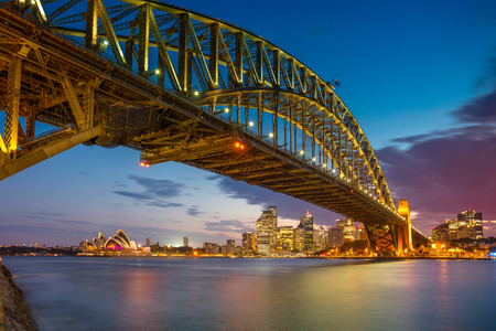 wales: Sydney. Cityscape image of Sydney, Australia with Harbour Bridge during summer sunset.