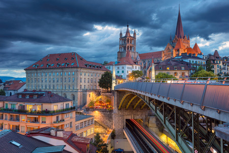 City of Lausanne. Cityscape image of downtown Lausanne, Switzerland during twilight blue hour. Banco de Imagens - 83734910