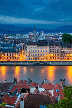 Grenoble. Aerial cityscape image of Grenoble, France during twilight blue hour. Banco de Imagens