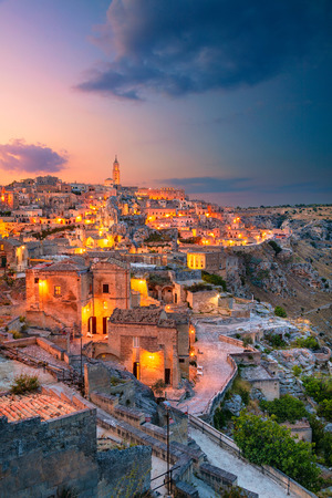 Matera, Italy. Cityscape aerial image of medieval city of Matera, Italy during beautiful sunset.