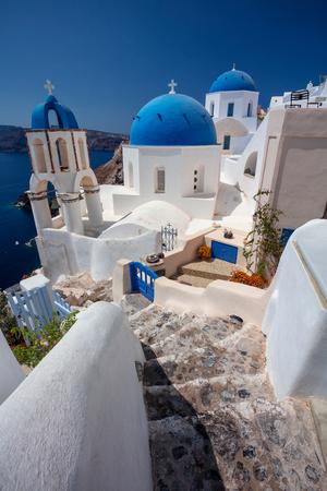Oia, Santorini. Image of famous cyclades village Oia located at the island of Santorini, South Aegean, Greece. Stock Photo