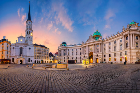 Vienna, Austria. Cityscape image of Vienna, Austria with St. Michaels Church and located at St. Michael Square during sunrise.