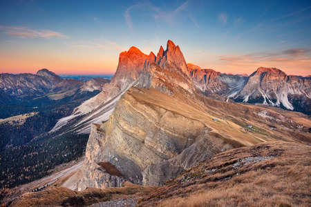 Dolomites. Landscape image of famous Dolomites mountain peaks glowing in beautiful golden evening light at sunset in autumn, South Tyrol, Italy.