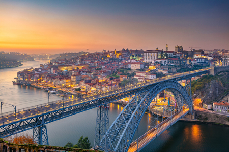 Porto, Portugal. Cityscape image of Porto, Portugal with the famous Luis Bridge and the Douro River during sunset. Stock Photo