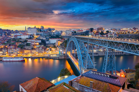 Porto, Portugal. Cityscape image of Porto, Portugal with the famous Luis I Bridge and the Douro River during dramatic sunset.