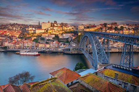 Porto, Portugal. Aerial cityscape image of Porto, Portugal with the Douro River and the Luis I Bridge during sunrise.