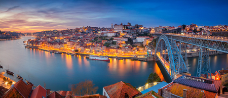 Porto, Portugal. Panoramic cityscape image of Porto, Portugal with the famous Luis I Bridge and the Douro River during dramatic sunset. Stock Photo