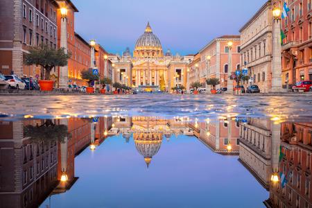 Rome, Vatican City. Cityscape image of illuminated Saint Peter`s Basilica and Street Via della Conciliazione, Vatican City, Rome, Italy. Stock Photo