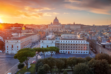 Rome, Vatican City. Aerial cityscape image of Vatican City with the Saint Peter Basilica, Rome, Italy during beautiful sunset. Stock Photo