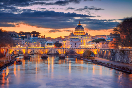 Rome, Vatican City. Cityscape image of Rome and Vatican City with the Saint Peter Basilica during beautiful sunset.