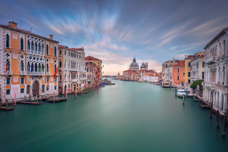 Venice, Italy. Cityscape image of Grand Canal in Venice, with Santa Maria della Salute Basilica in the background, during sunset.