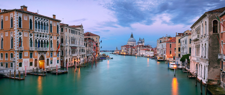 Venice, Italy. Panoramic cityscape image of Grand Canal in Venice, with Santa Maria della Salute Basilica in the background, during sunset Stock Photo - 122780465