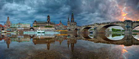 Dresden, Germany. Panoramic cityscape image of Dresden, Germany with reflection of the city in the Elbe river, during dramatic sunset. Stock Photo - 122780566