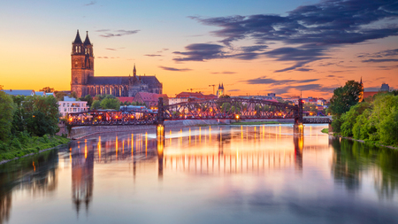 Cityscape image of Magdeburg, Germany with reflection of the city in the Elbe river, during sunset, Dresden, Germany.
