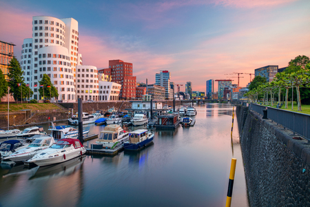 Cityscape image of Dusseldorf, Germany with the Media Harbor in the Rhine river, during sunset, Dusseldorf, Germany. Stock Photo - 124209429
